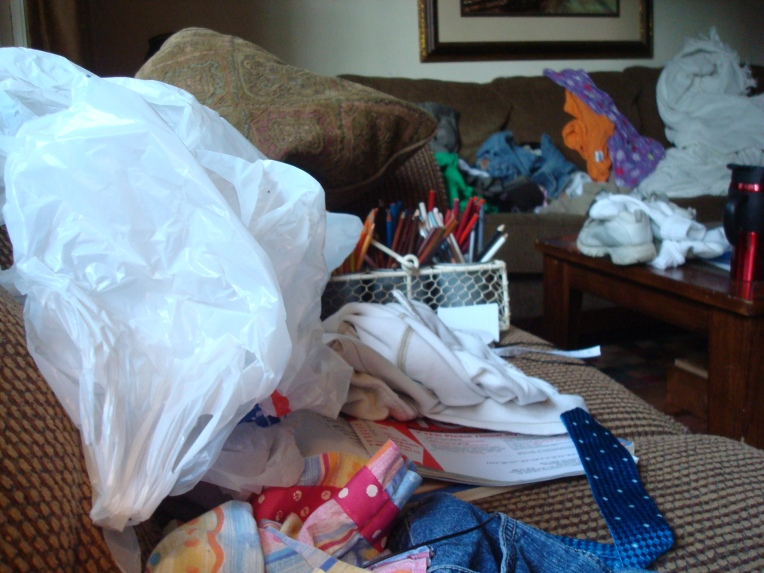 Two couches - covered in clothes, toys, art supplies .... almost all are Joy's things of responsibility