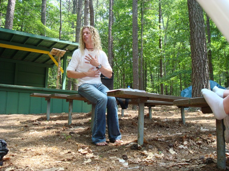 Phil Joel sharing at the Woods Stage