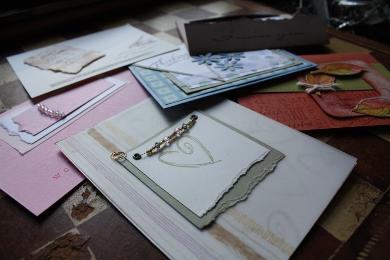 greeting cards (including the far right with leaves on rust paper that is a design by Julie Ebersole