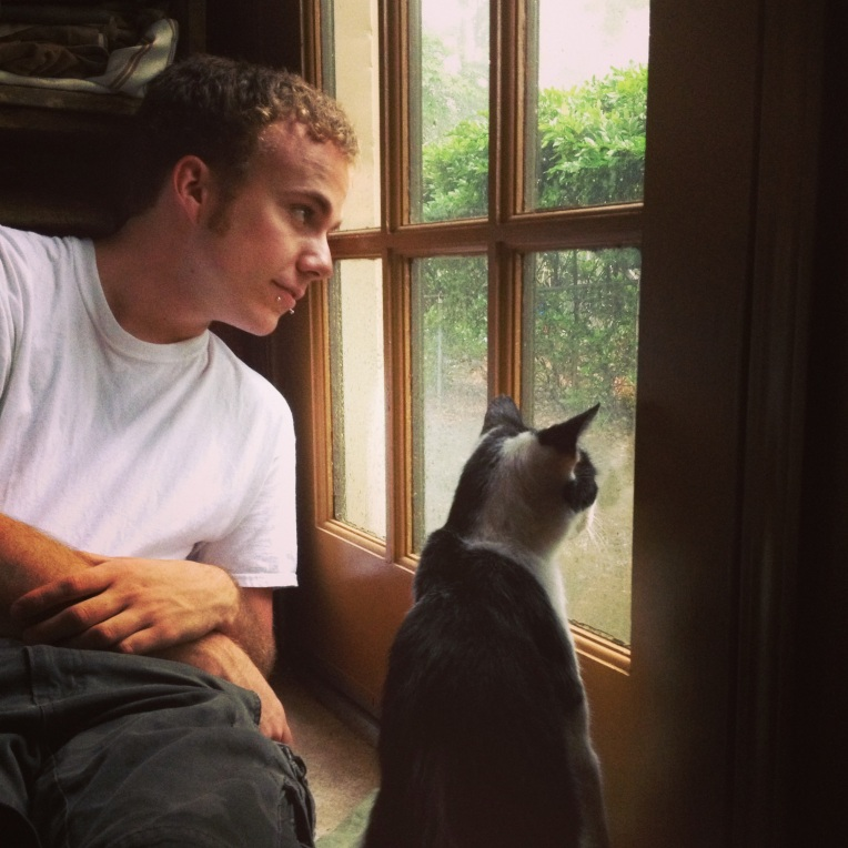 James & Smudge watching the rain outside