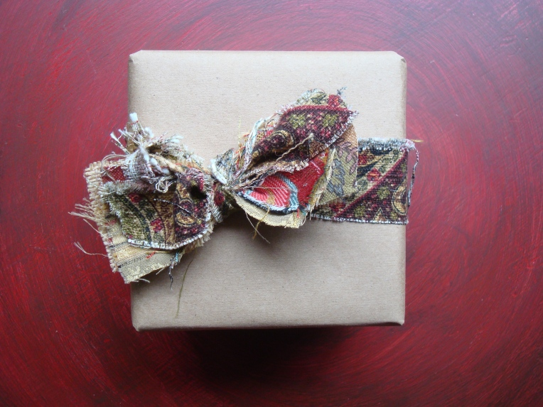 Wrapped gift - plain brown paper & personalized, layered fabric