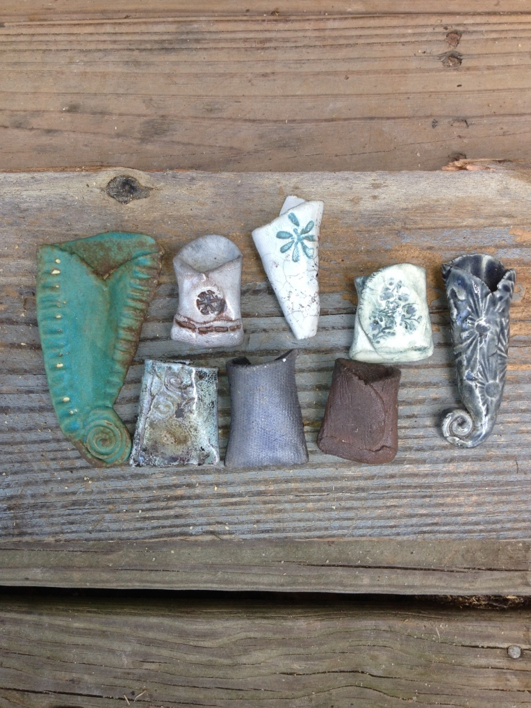 A few of Elizabeth's tiny clay vases - size reference: the little brown one is about the size of a quarter
