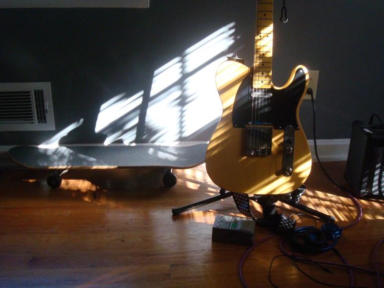 Guitars, skateboards & steel gray walls